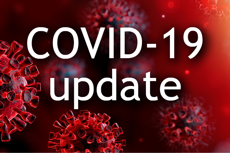 "A graphic reading ""COVID-19 update"" with red germs in the background."