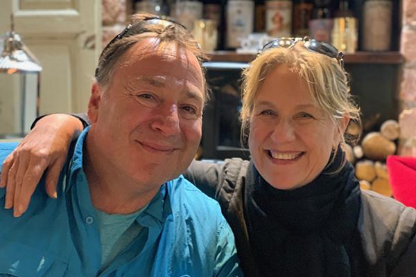 Ken Haigler smiling and sitting next to his partner Gina Janas
